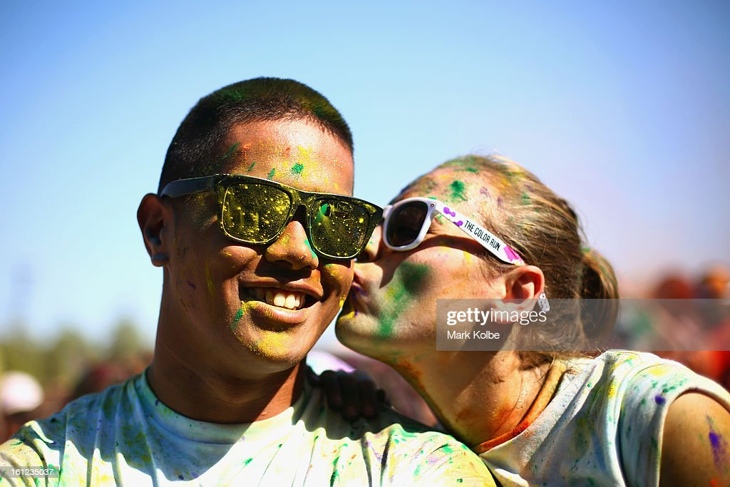 Competitors pose after finishing the Colour Run at Sydney Olympic Park on February 10, 2013 in Sydney, Australia.