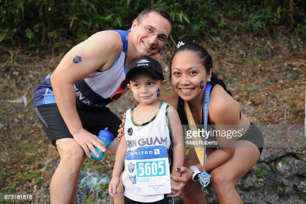 Competitors pose for a photgraph during the United Airlines Guam Marathon 2017 on April 9 2017 in Guam Guam