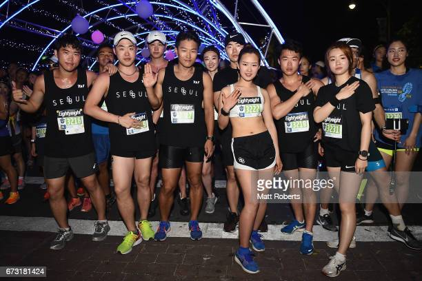 Competitors pose for a photograph during the United Airlines Guam Marathon 2017 on April 9 2017 in Guam Guam