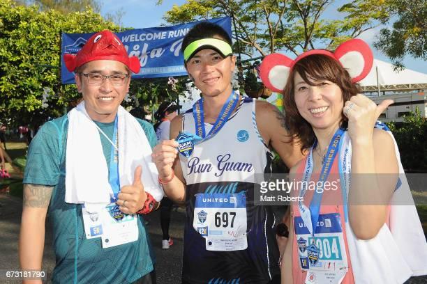 Competitors pose for photographs after the United Airlines Guam Marathon 2017 on April 9 2017 in Guam Guam