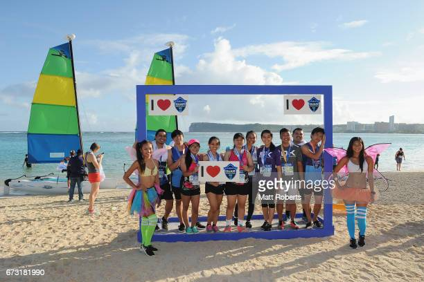 Competitors poses for photographs on the beach after the United Airlines Guam Marathon 2017 on April 9 2017 in Guam Guam