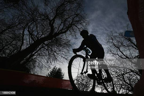 Competitors practice the course before the 'Veteran Men 50' category race at the 2013 National CycloCross Championships in Peel Park on January 12...
