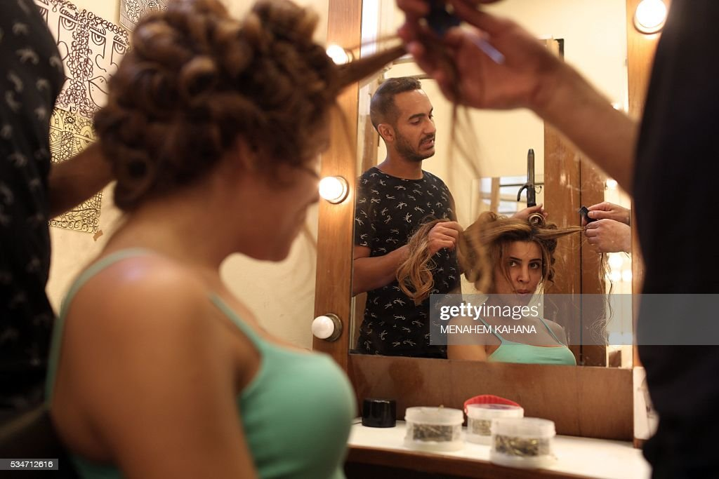 Competitors prepare for Israel's first Miss Trans beauty pageant at Habima national theater in Tel Aviv on May 27, 2016, which marks the beginning of the 2016 Pride events. / AFP / MENAHEM