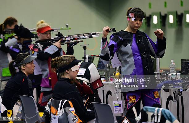 Competitors prepare for the race prior to the qualification round of 10m air rifle category for women in AUDI Arena of Gyor on February 26 2016...