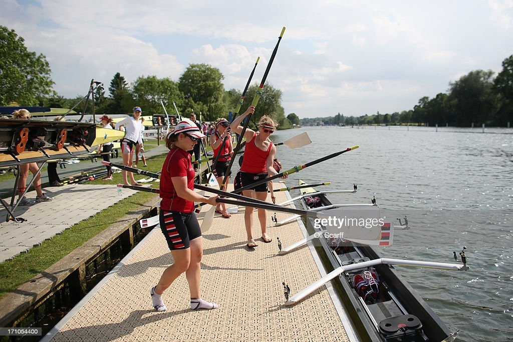 Competitors prepare to take to the water at the end of the first day of the Henley Women's Regatta on June 21, 2013 in Henley-on-Thames, England. The annual 3-day event, which has taken place since 1988, sees female crews from the UK and abroad compete on the Henley Royal Regatta course. In the past, several female rowers who have enjoyed success at the Henley Women's Regatta have gone on to win Olympic medals in the sport.