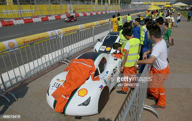 Competitors queue for a safety inspection in fuelefficient vehicles designed by students during the Shell Ecomarathon challenge at Luneta Park in...