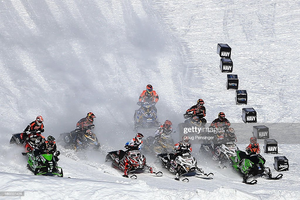 Competitors race for the hole shot in the first round of Snowmobile Snocross at Winter X Games Aspen 2013 at Buttermilk Mountain on January 27, 2013 in Aspen, Colorado.