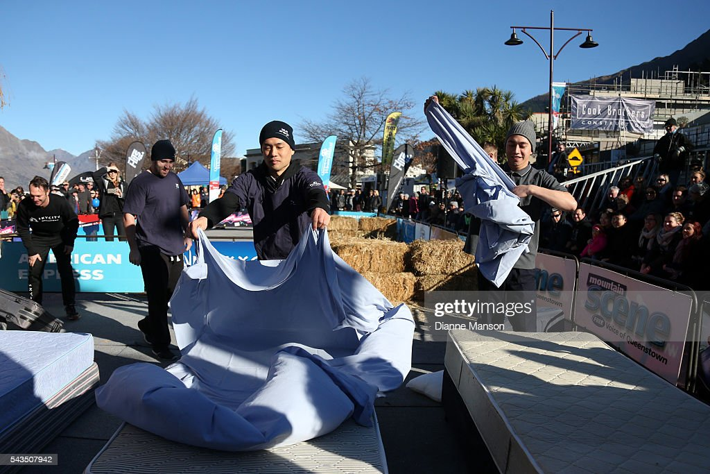 Competitors race to make beds in the Hospitality race during the Queenstown Winter Festival on June 29, 2016 in Queenstown, New Zealand.