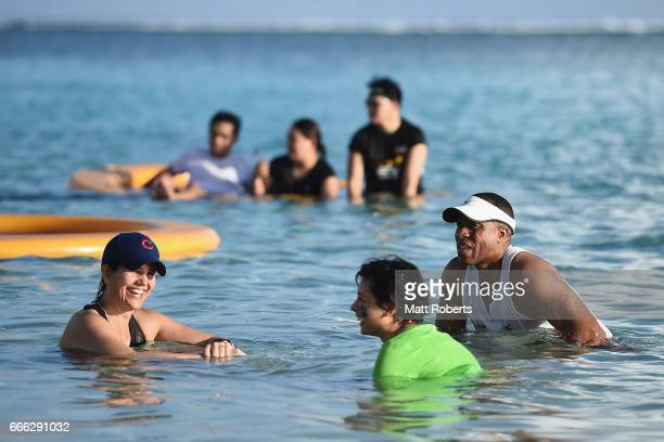 Competitors relax in the water after the United Airlines Guam Marathon 2017 on April 9 2017 in Guam Guam