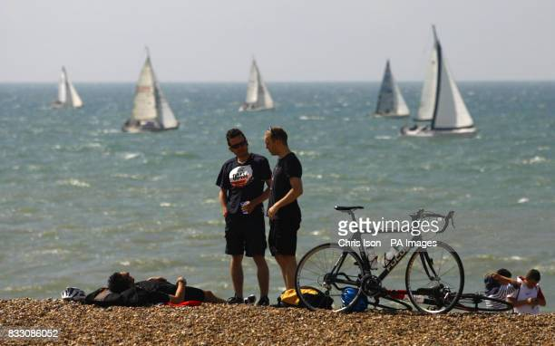 Competitors relax on the beach after arriving in Brighton after completing the British Heart Foundation London to Brighton Bike Ride