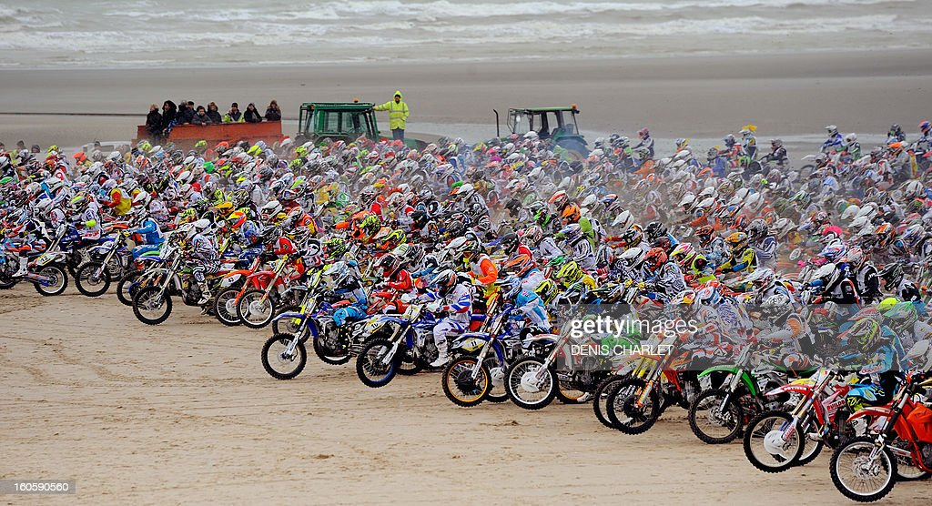 Competitors ride during the 8th edition of the Touquet Enduropal motorcycling race on February 3, 2013 on the beach in Le Touquet, northern France. The Touquet Enduropal motorcycling replaces the traditional Enduro, created by Thierry Sabine motorcycle racer - founder and main organizer of Paris Dakar, in the 80s. Some 1,000 competitors attend the 11,800 km race.