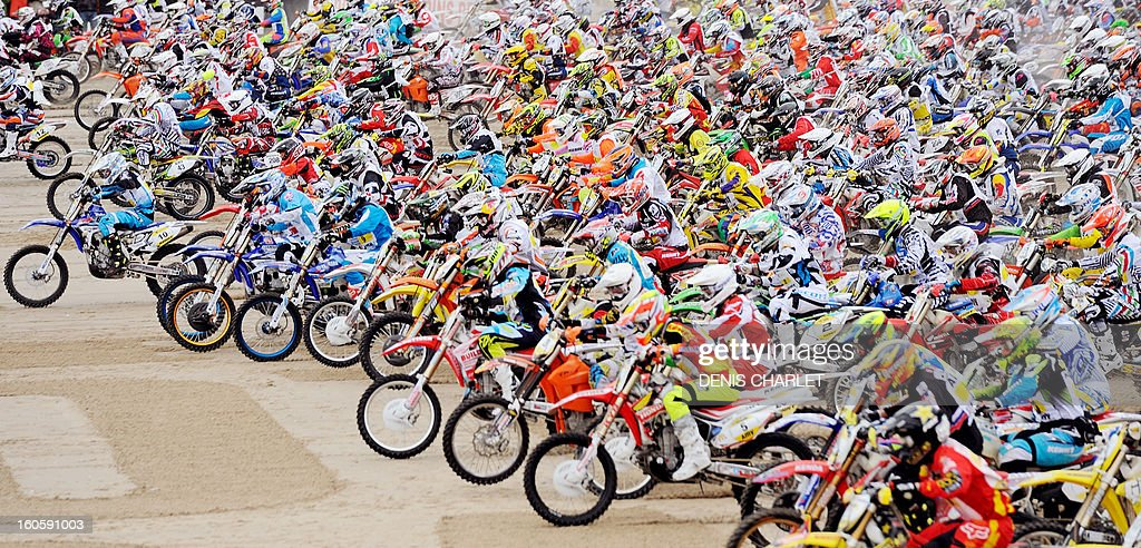 Competitors ride on February 3, 2013 on the beach of Le Touquet, northern France, during the 8th edition of the Touquet Enduropal motorcycling race.