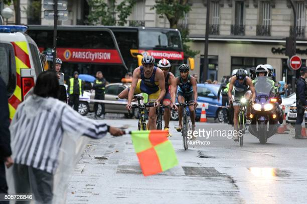 Competitors ride their bikes during the Paris triathlon on July 2 2017 in Paris An unprecedented course located amidst the most beautiful monuments...