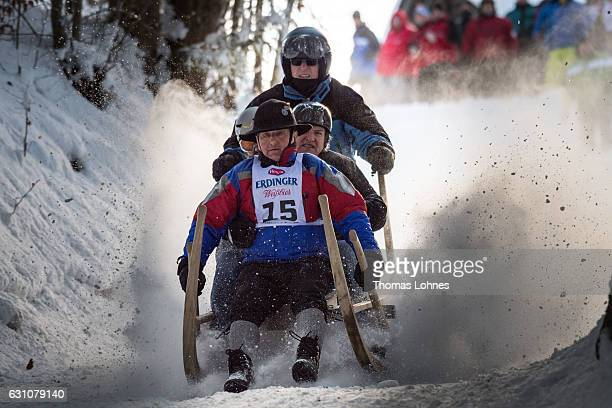 Competitors riding a traditional horn sled speed down the mountain during the 48th annual horn sled race on January 6 2017 in GarmischPartenkirchen...