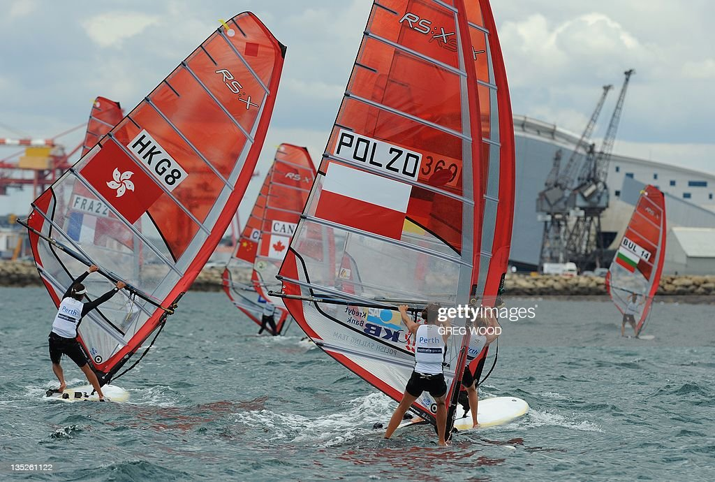 Competitors round a mark in the first Gold Fleet race in the