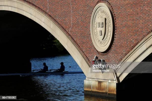 Competitors row beneath the John W Weeks bridge during the Head of the Charles Regatta on October 21 2017 in Boston Massachusetts