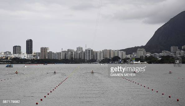 TOPSHOT Competitors row during the Women's Pair rowing competition at the Lagoa stadium during the Rio 2016 Olympic Games in Rio de Janeiro on August...