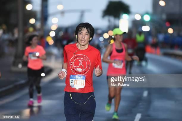 Competitors run at dawn during the United Airlines Guam Marathon 2017 on April 9 2017 in Guam Guam