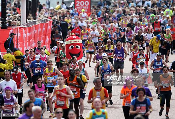 Competitors run down the Mall towards the finish line during the Virgin London Marathon 2013 on April 21 2013 in London England