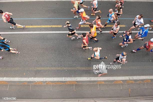 Competitors run during the 36th Paris Marathon on April 15 2012 in Paris France