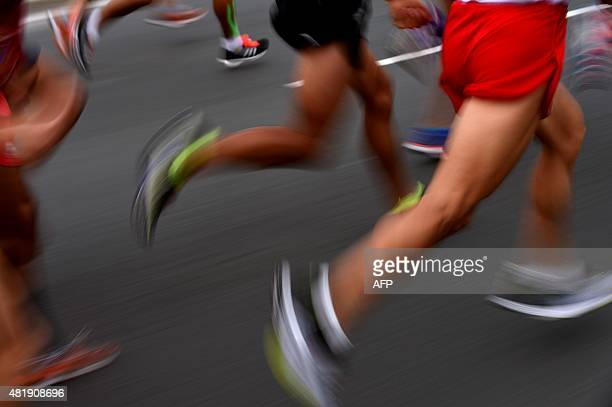 Competitors run during the Men's Marathon at the 2015 Pan American Games in Toronto Canada July 25 2015 AFP PHOTO/POOL/HECTOR RETAMAL