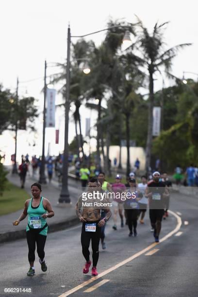 Competitors run during the United Airlines Guam Marathon 2017 on April 9 2017 in Guam Guam