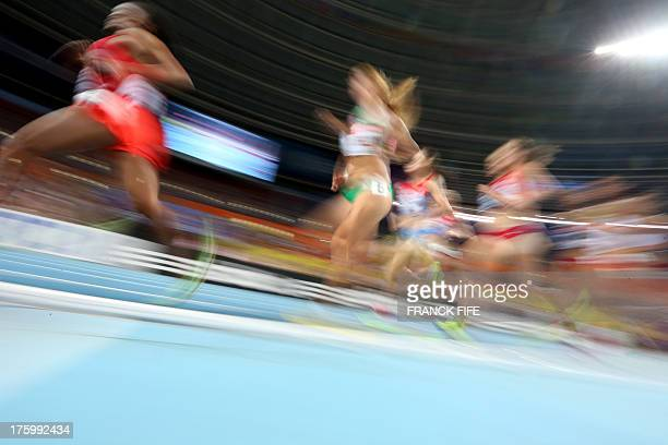 Competitors run during the women's 10000 metres final at the 2013 IAAF World Championships at the Luzhniki stadium in Moscow on August 11 2013 AFP...