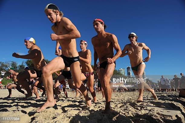 Competitors run in the under 19 2km Beach run during the 2011 Australian Surf Lifesaving Championships at Kurrawa Beach on April 7 2011 in Gold Coast...