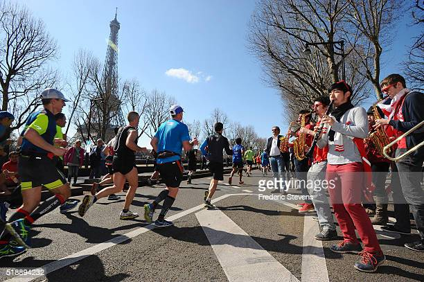 Competitors run near of the Eiffel Tower during the 40th Paris Marathon crossing the French capital on April 3 2016 in Paris France 57000...