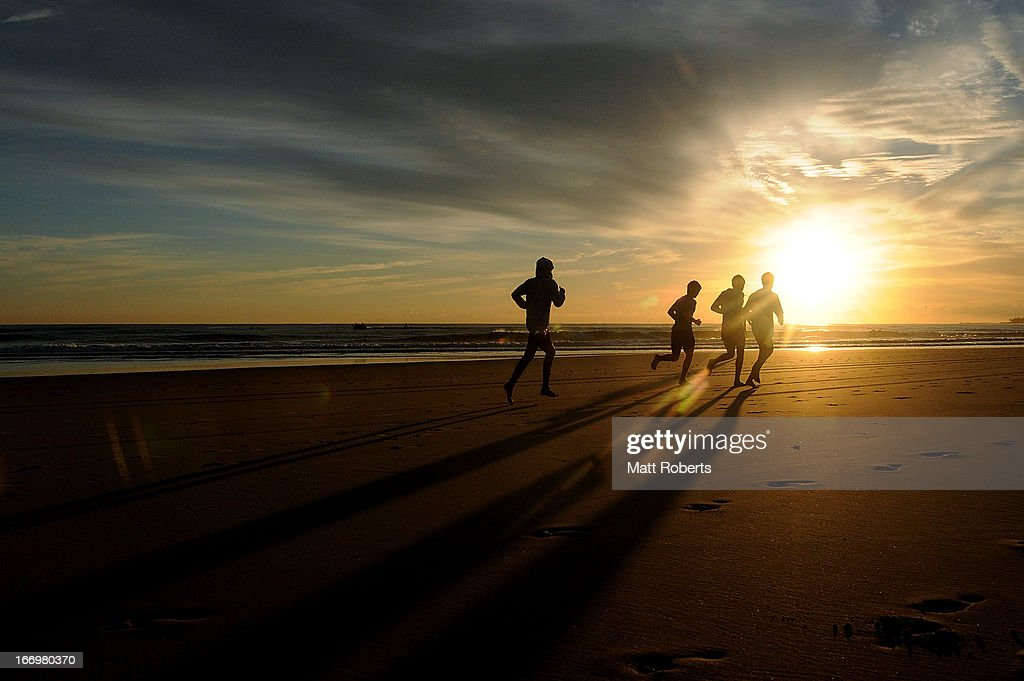 Competitors run on the beach prior to the start of day three of the 2013 Australian National Surf Lifesaving Titles on April 19, 2013 on the Gold Coast, Australia.