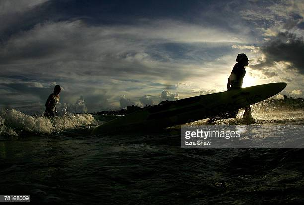 Competitors run out of the water with their boards during the women board rescue event during test one of the International Surf Challenge at Bondi...