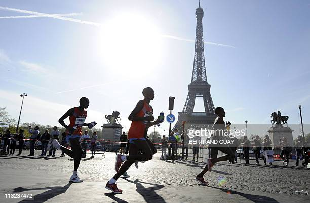Competitors run past the Eiffel Tower during the 35th Paris Marathon on April 10 2011 in Paris AFP PHOTO BERTRAND GUAY