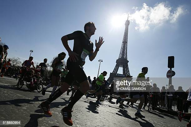 TOPSHOT Competitors run past the Eiffel Tower during the 40th Paris Marathon on April 3 2016 in Paris Some 57000 participants from 160 countries have...