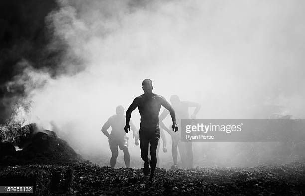 Competitors run through a fire pit during 2012 Tough Mudder at Glenworth Valley on September 23 2012 in Sydney Australia