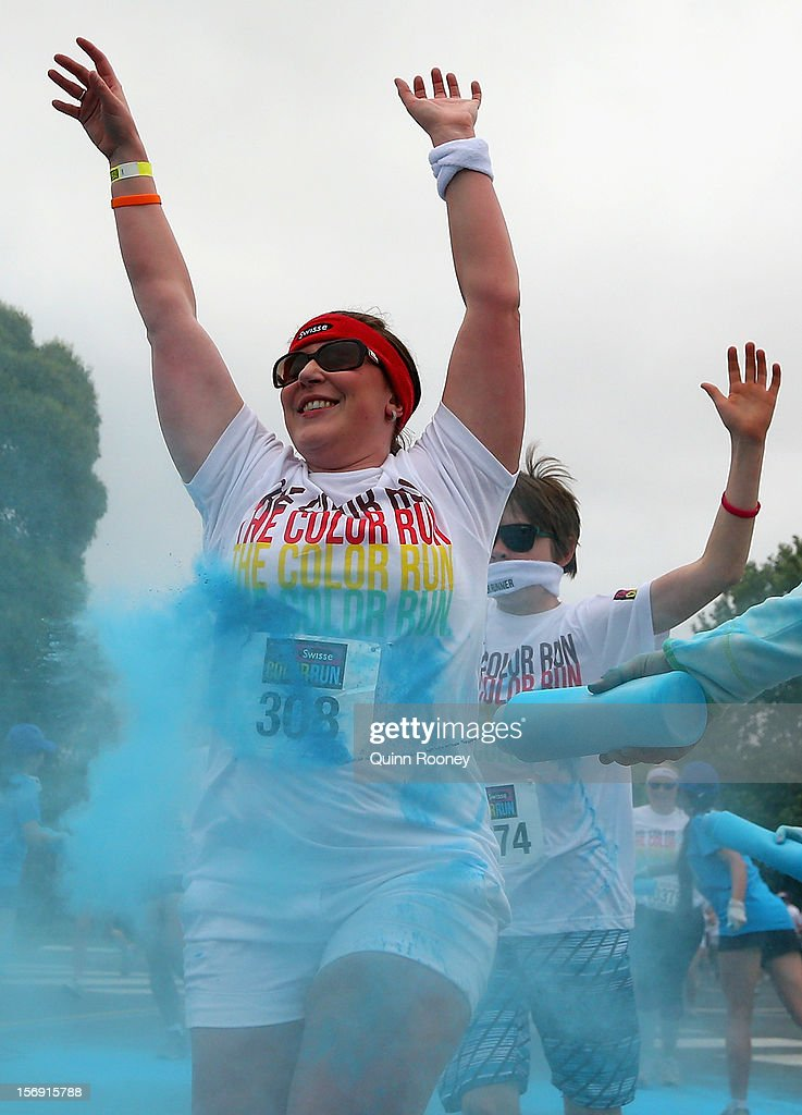 Competitors run through the blue colour station during the Colour Run on November 25, 2012 in Melbourne, Australia.