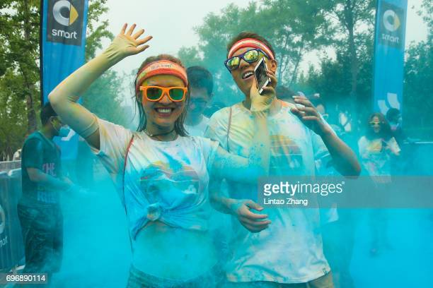 Competitors run through the blue colour station during the Colour Run at the Beijing International Garden Expo park on June 17 2017 in Beijing China