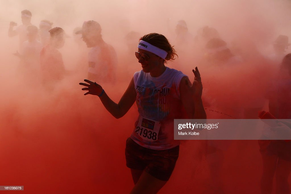 Competitors run through the pink colour throw area during the Colour Run at Sydney Olympic Park on February 10, 2013 in Sydney, Australia.