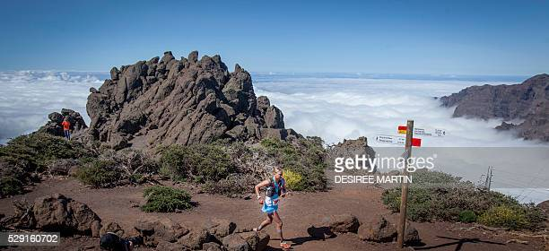 Competitors run to a summit in Caldera National Park during the Transvulcania ultra trail event on May 7 2016 on the Spanish Canary island of La...