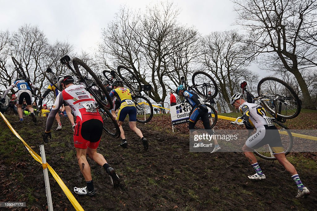 Competitors run up a hill as they take part in the 'Veteran 40-49 Men' category race at the 2013 National Cyclo-Cross Championships in Peel Park on January 12, 2013 in Bradford, England. The sport of cyclo-cross, featuring lightweight bikes with off-road tyres, has dramatically increased in popularity over the past few years. Cyclo-cross courses are often run over a mixture of terrains from tarmac to mud and frequently include obstacles or steep inclines where riders have to carry their bike.