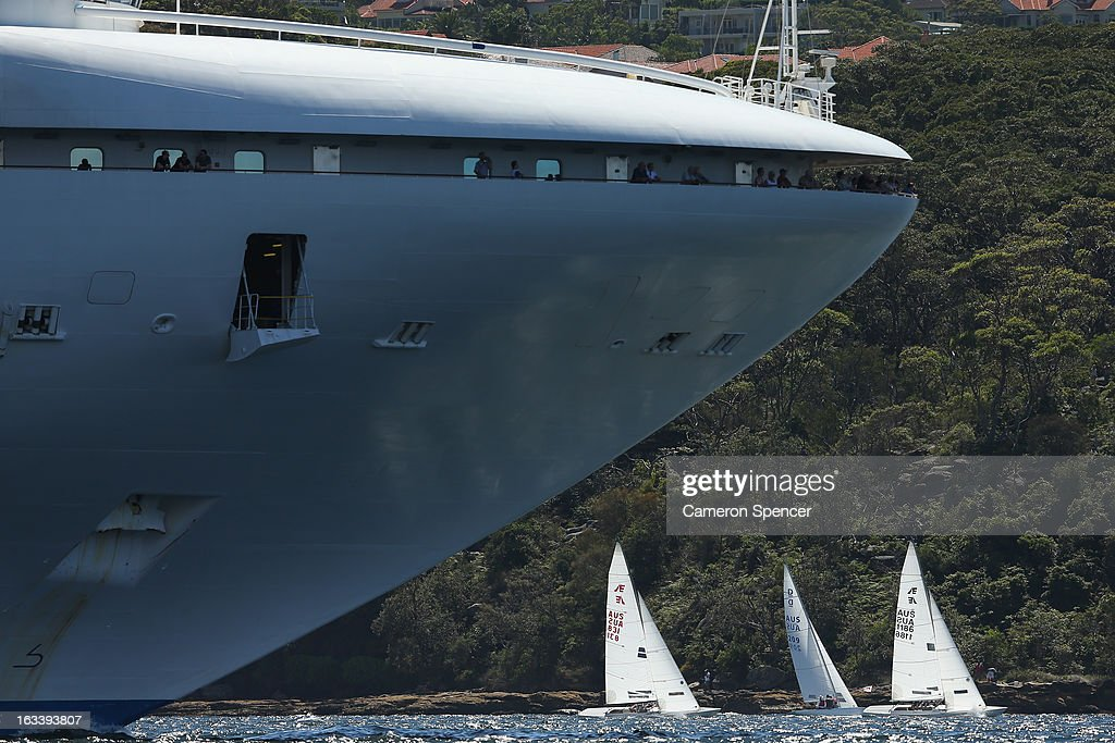 Competitors sail next to the Diamond Princess cruise ship during the Sydney Regatta on Sydney Harbour, on March 9, 2013 in Sydney, Australia.