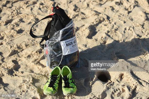 Competitors shoes and back are seen on the beach after the United Airlines Guam Marathon 2017 on April 9 2017 in Guam Guam
