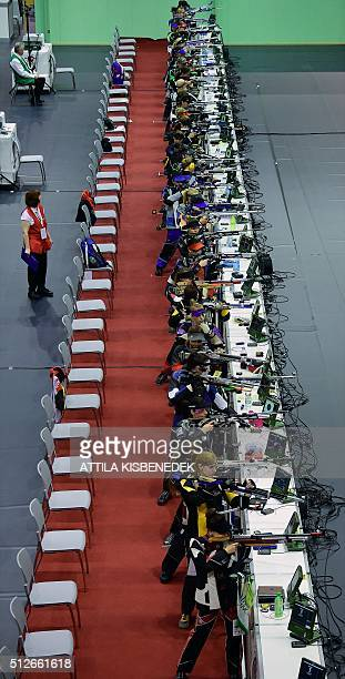Competitors shoot in AUDI Arena of Gyor during the qualification round of 10m air rifle category for women on February 26 2016 during the 'Shooting...