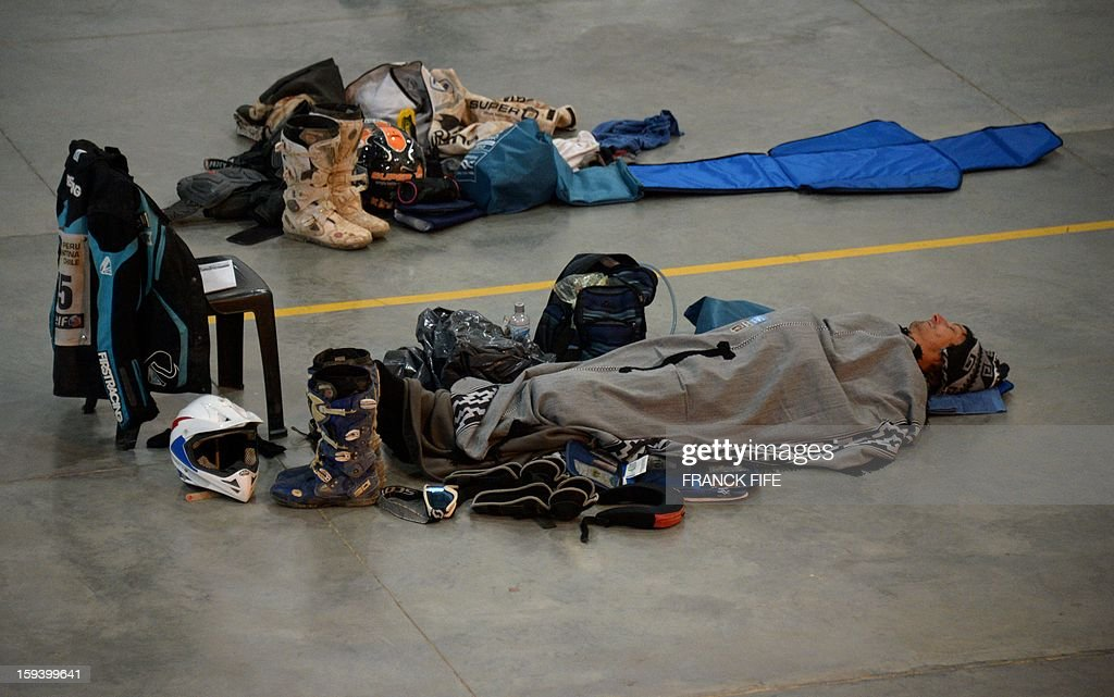 Competitors sleep in Cachi after the Stage 7 of the Dakar 2013 between Calama and Salta, Argentina, on January 11, 2013. The rally will take place in Peru, Argentina and Chile January 5-20. AFP PHOTO / FRANCK FIFE