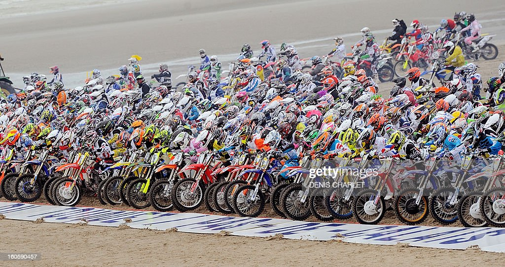 Competitors stand ready behind the departure line during the 8th edition of the Touquet Enduropal motorcycling race on February 3, 2013 on the beach in Le Touquet, northern France. The Touquet Enduropal motorcycling replaces the traditional Enduro, created by Thierry Sabine motorcycle racer - founder and main organizer of Paris Dakar, in the 80s. Some 1,000 competitors attend the 11,800 km race.