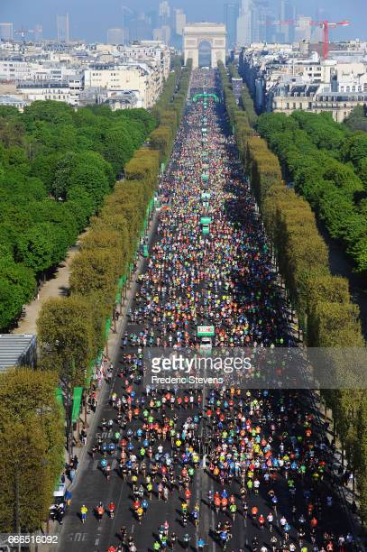 Competitors start on the Champs Elysees avenue for the 41th Paris Marathon 2017 on April 9 2017 in Paris France For the first time in history a...