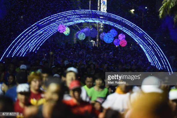 Competitors start running before dawn in the 5 km race during the United Airlines Guam Marathon 2017 on April 9 2017 in Guam Guam
