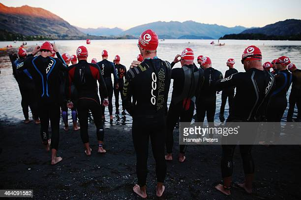 Competitors start the swim leg of Challenge Wanaka on February 22 2015 in Wanaka New Zealand