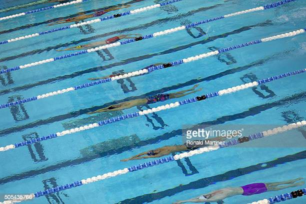 Competitors swim in the Men's 100 meter backstroke during the Arena Pro Swim Series at Austin on January 17 2016 in Austin Texas