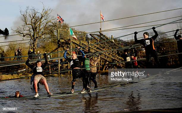 Competitors tackle a rope bridge as they take part in the Tough Guy 2010 race on January 31 2010 in Telford England