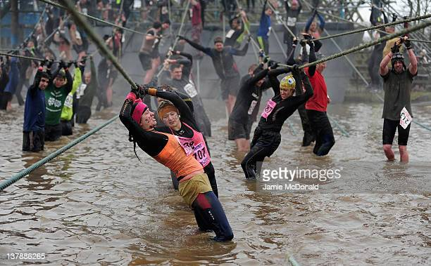 Competitors tackle a rope bridge during the Tough Guy Challenge endurance race on January 29 2012 in Telford England Every year thousands of people...